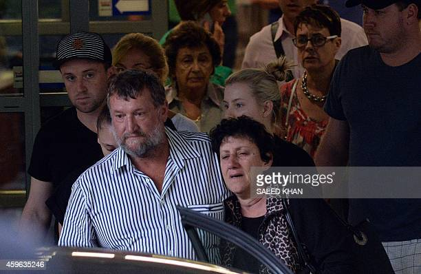 The parents of Australian cricket batsman Phil Hughes father Greg and mother Virginia with other family members leave St Vincents Hospital in Sydney...