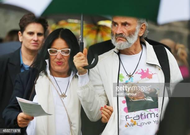 The parents of Australian MH17 victim Fatima Dyczynski Dr Jezy Dyczynski and Angela RudhartDyczynski leave after attending a national memorial...