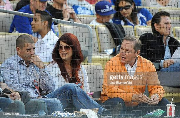 The parents of Bryce Harper of the Washington Nationals, Ron Harper and Sheri Harper sit with agent Scott Boras during the game against the Los...