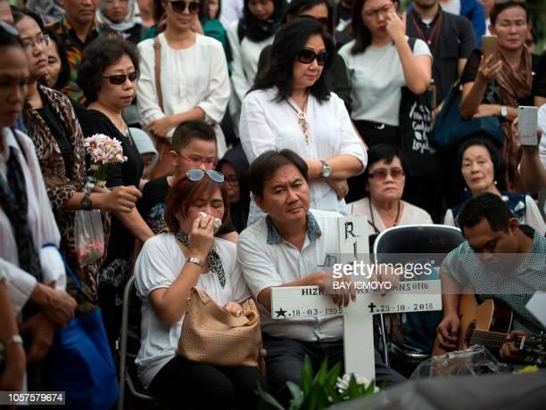 The parents of Hizkia Jorry Saroinsong a victim of the illfated Lion Air flight JT 610 Johan Haris Saruinsong and Shila Venita attend the funeral of...