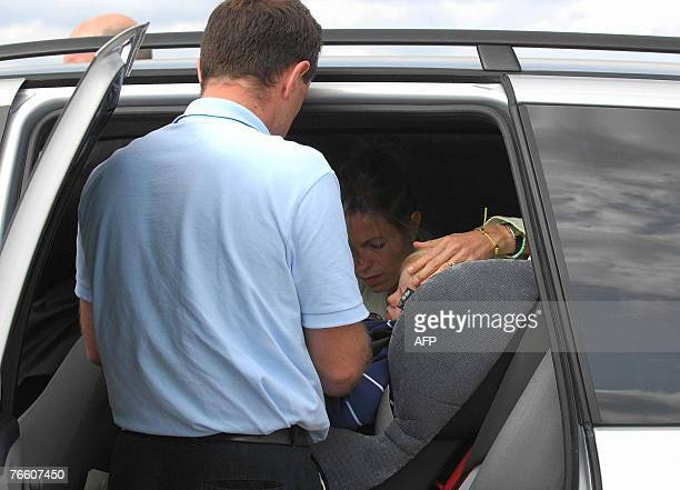 The parents of missing toddler Madeleine McCann Kate and Gerry with their twoyearold twin children Sean and Amelie take place in a car as they arrive...