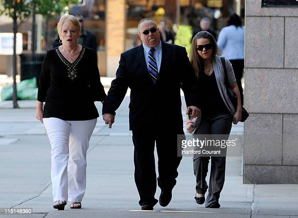 The parents of Raymond Clark Diane left and Raymond Clark II and Clark's fiancee Jennifer Hromadka enter New Haven County Courthouse in New Haven...