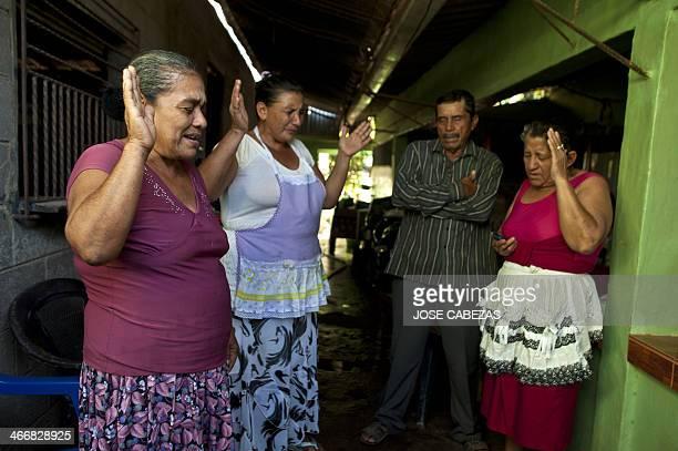 The parents of Salvadorean castaway Jose Salvador Alvarenga Jose Ricardo Orellana and Maria Julia Alvarenga and other relatives pray at their house...