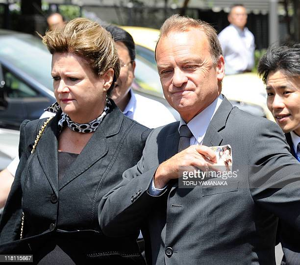 The parents of slain 22-year-old British teacher Lindsay Ann Hawker, father Bill Hawker and mother Julia , arrive at Chiba District Court in Chiba,...