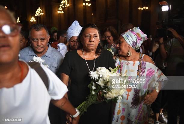 The parents of slain Brazilian councilwoman Marielle Franco Antonio da Silva and Marinete da Silva leave the church after attending a mass on the...