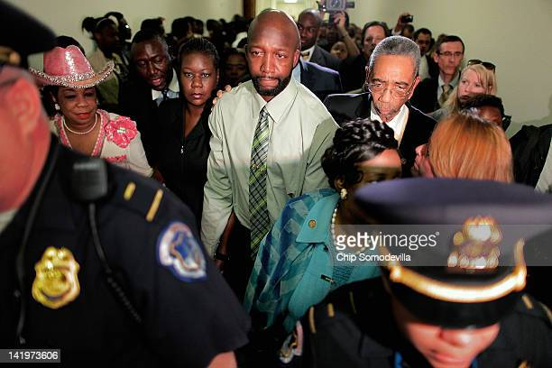 The parents of Trayvon Martin Tracy Martin and Sybrina Fulton are escorted by Rep Frederica Wilson Rep Bobby Rush and Rep Sheila JacksonLee after...