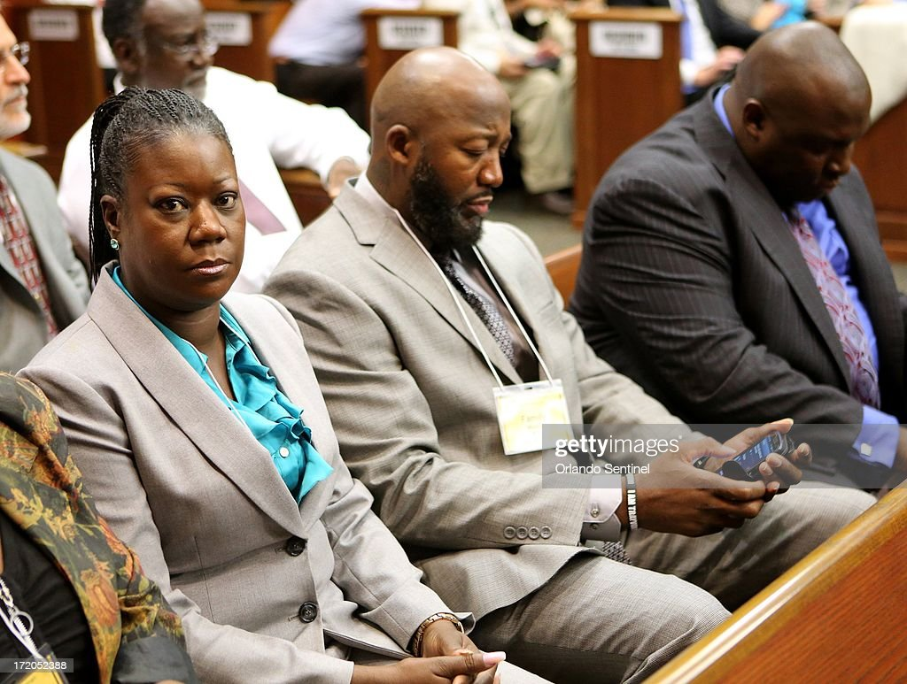 The parents of Trayvon Martin, Tracy Martin, left, and Sybrina Fulton, arrive for the George Zimmerman trial in Sanford, Florida, Monday, July 1, 2013. Zimmerman is accused in the fatal shooting of Trayvon Martin.