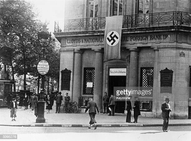 The Paris branch of the British Lloyds Bank with a swastika hanging over its door after being converted into a German bank during the Nazi occupation...