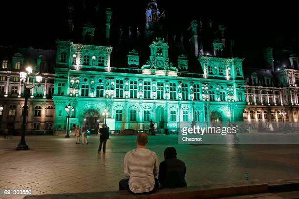 The Paris city Hall is illuminated in green following the announcement by US President Donald Trump that the United States will withdraw from the...