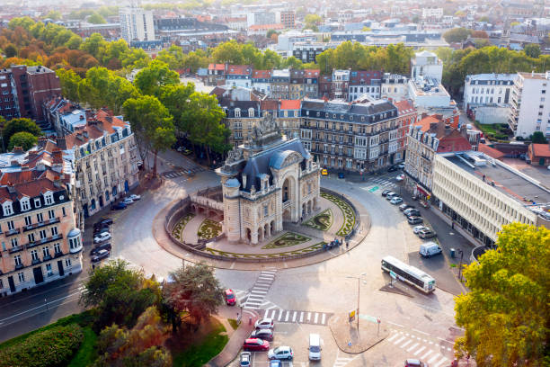 the paris gate monument (porte de paris), view from the belfry of lille city hall in october, lille, north of france - france stock pictures, royalty-free photos & images