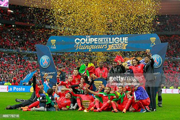 The Paris SaintGermain FC poses for a photo with the Coupe de la Ligue Trophy after the French League Cup Final game between SC Bastia and Paris...