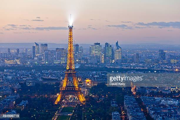 The Paris skyline and the Eiffel Tower during the blue or magic hour.