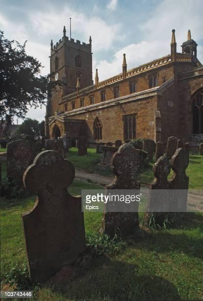 The parish church and graveyard in Middle Tysoe StratforduponAvon Warwickshire circa 1985