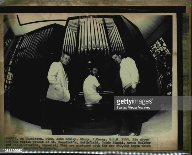 LR the parish priest of St Benedict's Smithfield Guido Pinchi organ Builder and Nello Catarcia organist They are pictured with the new $40000 organ...