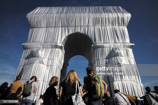 The Parisians come to see packaging of the Arc de Triomphe, posthumous work of Christo on September 22, 2021 in Paris, France. The Arc de Triomphe...