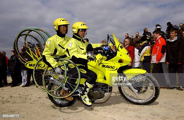The ParisRoubaix Classic 2004 The Mavic motorbike spare wheel crew Cyclisme ParisRoubaix 2004 Motards de Mavic
