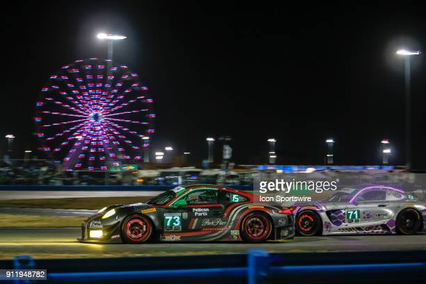 The Park Place Motorsports Porsche 911 GT3 R of Jörg Bergmeister Patrick Lindsey and Tim Pappas and the P1 Motorsports MercedesAMG GT3 of Robby Foley...