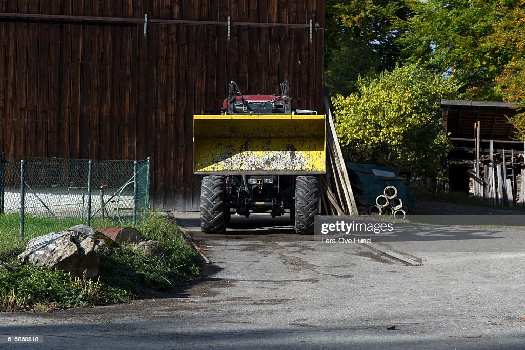 The parked tractor : Stock Photo