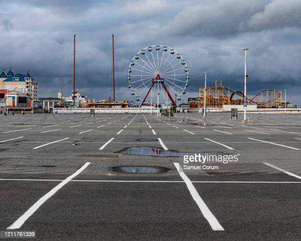 The parking lot and rides of Jolly Roger at the Pier remain empty and silent on April 26 2020 in Ocean City Maryland The coronavirus pandemic shut...