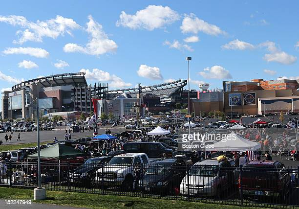 The parking lot at Patriot Place is filled with tailgating fans before the New England Patriots play the Arizona Cardinals at Gillette Stadium in the...