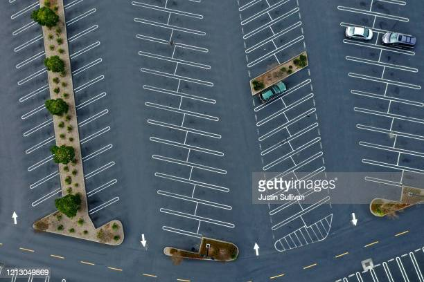 The parking lot at The Village at Corte Madera shopping mall is nearly empty on March 17 2020 in Corte Madera California Seven San Francisco Bay Area...