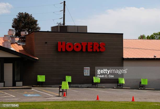 The parking lot is empty at Hooters of Augusta on Washington Road as they are only open to accept takeout and delivery orders due to the coronavirus...