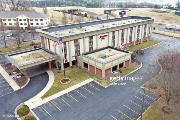 The parking lot is nearly at a Hampton Inn hotel on March 24 2020 in Rockford Illinois The American Hotel and Lodging Association anticipates the...