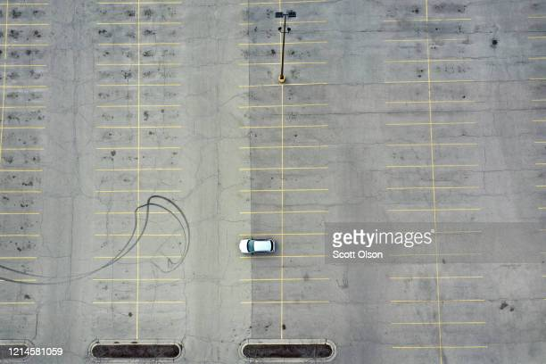 The parking lot is nearly deserted at Forest Plaza on March 24 2020 in Rockford Illinois Forest Plaza is a shopping mall with more than 30 stores...