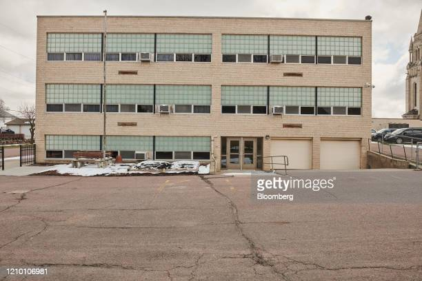 The parking lot of the Cathedral of Saint Joseph school stands empty in Sioux Falls South Dakota US on Wednesday April 15 2020 South Dakota Governor...