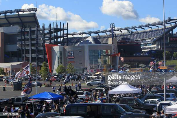 The parking lots at Patriots Place were filling with tailgating fans awaiting the New England Patriots' season home opener against the Arizona...