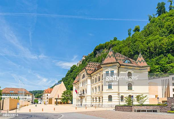 the parliament building with vaduz castle - liechtenstein stock pictures, royalty-free photos & images