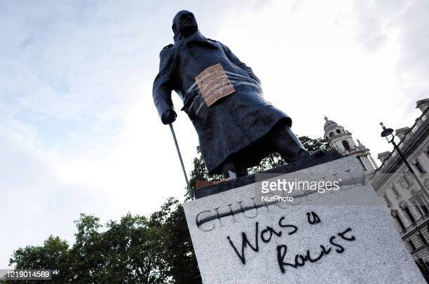 The Parliament Square statue of Britain's wartime leader Winston Churchill stands defaced with the words 'Was a Racist' as Black Lives Matter...