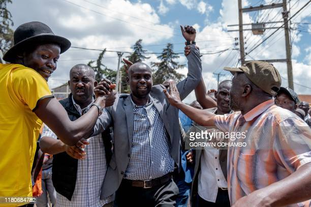 The parliamentary candidate of Kenya's opposition party the Orange Democratic Movement Imran Okoth reacts after casting his vote as byelections for a...