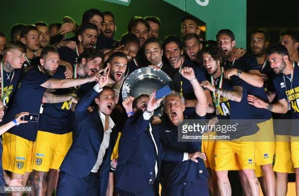The Parma Calcio players celebrate the return in Serie A with the Trophy at Stadio Ennio Tardini on May 27, 2018 in Parma, Italy.