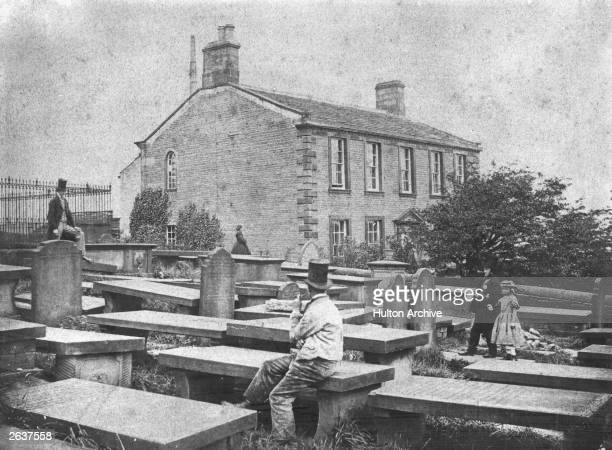 The Parsonage at Haworth Yorkshire home of the Bronte Family On the left is Dick Brook and in the foreground is Tom Ingle