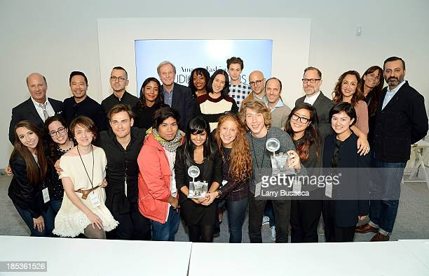 The Parson's team and judges pose during Amazon Fashion Studio Sessions at Williamsburg Photography Studio Opening on October 19 2013 in Brooklyn New...