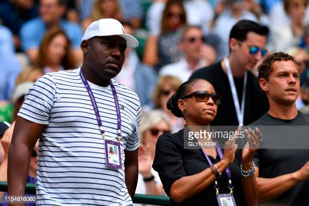The partents of US player Cori Gauff father Corey and mother Candi look on as Gauff plays against Romania's Simona Halep during their women's singles...