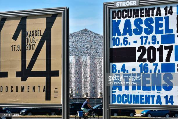 The 'Parthenon of Books' by Argentinian artist Marta Minujin can be seen between two billboards advertising the Documenta 14 art exhibition in Kassel...