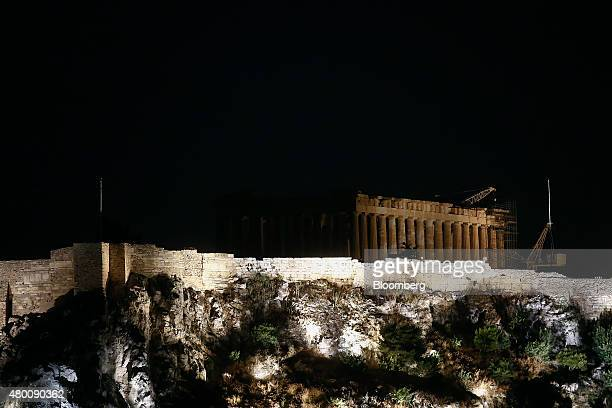 The Parthenon temple on Acropolis Hill is partially illuminated in Athens Greece on Thursday July 9 2015 The government of Greek Prime Minister...