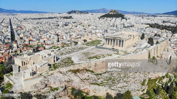 The Parthenon temple on Acropolis hill is seen deserted as deserted as concerns grow over the Coronavirus Outbreak in Athens , on 19 March 2020.