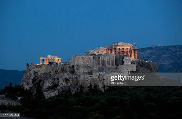 The Parthenon temple stands illuminated at night on Acropolis Hill in Athens Greece on Tuesday Aug 20 2013 A third aid program for Greece announced...