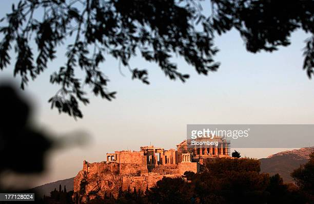 The Parthenon temple stands illuminated in evening sunlight on Acropolis Hill in Athens Greece on Tuesday Aug 20 2013 A third aid program for Greece...