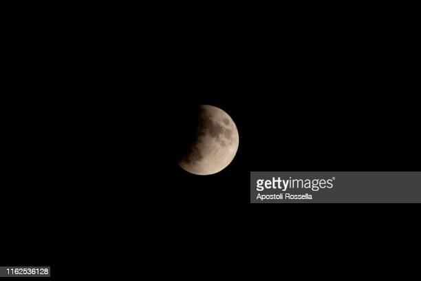 the partial eclipse of the moon, italy - undone stock pictures, royalty-free photos & images