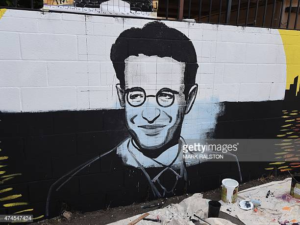 The partially completed portrait by artist Levi Ponce for his Memorial Day mural project of murdered journalist Daniel Pearl, near his old...