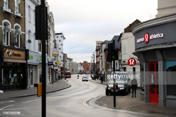 The partially deserted shopping high street in Richmond-Upon-Thames during the UK's third COVID-19 lockdown on January 19, 2021 in Richmond, London ....
