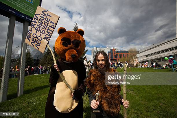The participants are seen during 'Monstration' a May Day comic demonstration at the central city street in Novosibirsk Russia on May 01 2016
