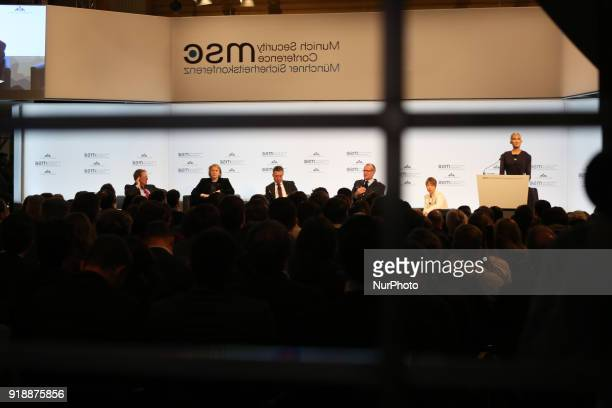 The participants of the panel are seen reflected in a mirror in Munich Germany on February 15 2018 Today the first panel of the Munich Security...
