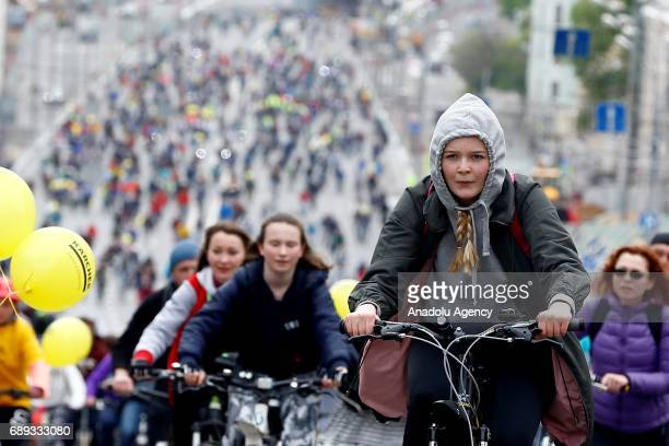 The participants ride their bicycles at the 6th Annual Moscow Bike Parade on Prospekt Akademika Sakharova in Moscow Russia on May 28 2017 The yearly...