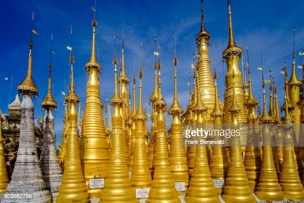 The partly restored monuments of Shwe Indein Pagoda are located on a hill above the village of Indein close to Inle lake