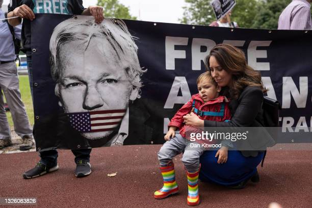 The partner of Julian Assange, Stella Morris with their son Max, join protesters and a group of cross party Mp's outside Belmarsh Prison on June 29,...